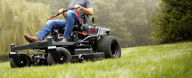 Man cutting yard with Troy-Bilt Zero-Turn Mower