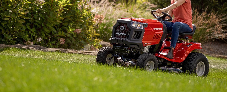 riding mower cutting grass