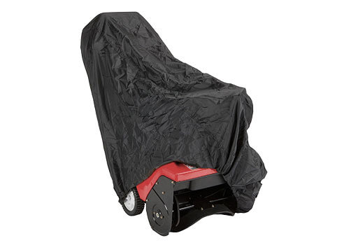 snow blower cover draped over single-stage snow blower